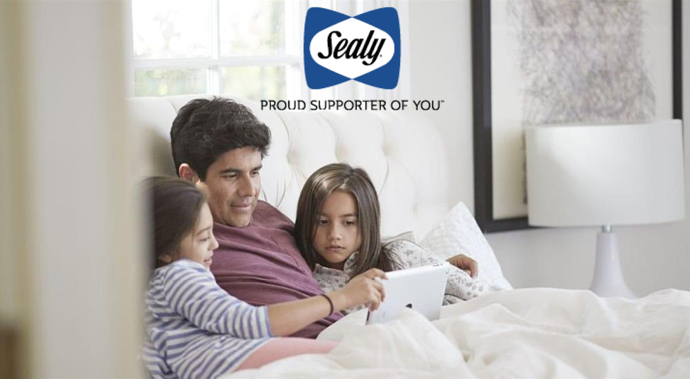 Cover Image - Family in bed watching iPad